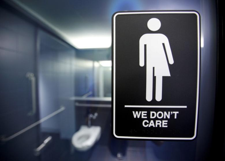 A sign protesting a recent North Carolina law restricting transgender bathroom access is seen in the bathroom stalls at the 21C Museum Hotel in Durham, North Carolina May 3, 2016.   REUTERS/Jonathan Drake/File photo