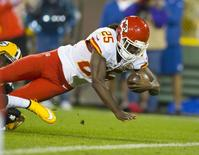 Sep 28, 2015; Green Bay, WI, USA; Kansas City Chiefs running back Jamaal Charles (25) dives for a touchdown during the first quarter against the Green Bay Packers at Lambeau Field. Mandatory Credit: Jeff Hanisch-USA TODAY Sports