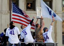 Chicago Cubs celebrate winning the team's first World Series in 108 years during a victory parade in Chicago, Illinois, U.S., November 4, 2016. REUTERS/Frank Polich