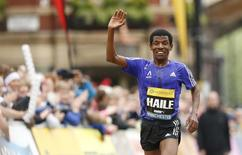 Athletics - Great CityGames Manchester 2015 - Manchester - 10/5/15 Ethiopia's Haile Gebrselassie waves as he approaches the finish line at the end of the Morrisons Great Manchester Run, during an interview afterwards he announced his retirement  Action Images via Reuters / Andrew Boyers Livepic