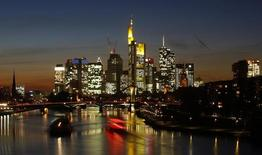 Ships are seen on river Main in front of the characteristic skyline with its banking towers in Frankfurt, October 30, 2013. REUTERS/Kai Pfaffenbach