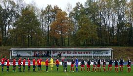 Former FIFA referee Hamdi Al Kadri conducts a German 9th division soccer match between TSV Pyrbaum and FC Altdorf in Pyrbaum, southern Germany, November 6, 2016. Picture taken November 6, 2016. Syrian migrant Al-Kadri was member of the referee team at high level FIFA matches, such as World Cup bouts before he came to Germany as a Syrian refugee.  REUTERS/Michael Dalder