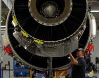 General Electric employee Ron Carlson inspects a CF6-80C engine at the GE Aviation Peebles Test Operations Facility in Peebles, Ohio, November 15, 2013. REUTERS/Matt Sullivan