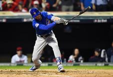 Nov 2, 2016; Cleveland, OH, USA; Chicago Cubs third baseman Kris Bryant hits a single against the Cleveland Indians in the fourth inning in game seven of the 2016 World Series at Progressive Field. Mandatory Credit: Tommy Gilligan-USA TODAY Sports - RTX2RMJF