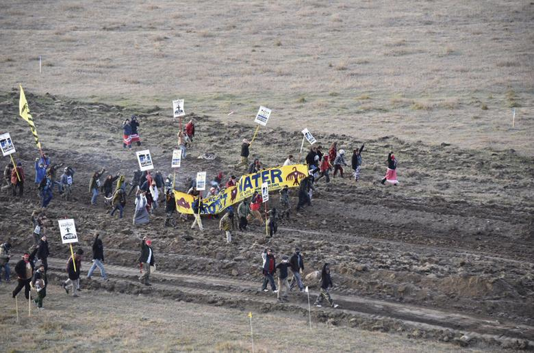 Protester gather near a pipeline being built by a group of companies led by Energy Transfer Partners LP at a construction site in North Dakota before being confronted by police October 22, 2016. Photo courtesy Morton County Sheriff's Office/Handout via REUTERS