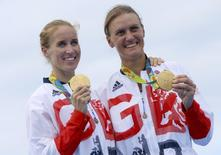 2016 Rio Olympics - Rowing - Victory Ceremony - Women's Pair Victory Ceremony - Lagoa Stadium - Rio De Janeiro, Brazil - 12/08/2016. Helen Glover (GBR) of Britain and Heather Stanning (GBR) of Britain pose with their gold medals. REUTERS/Murad Sezer