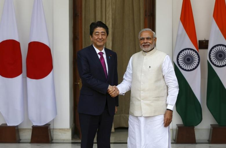 Japan's Prime Minister Shinzo Abe (L) shakes hands with his Indian counterpart Narendra Modi during a photo opportunity ahead of their meeting at Hyderabad House in New Delhi December 12, 2015. REUTERS/Adnan Abidi