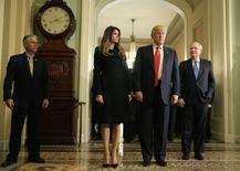 U.S. President-elect Donald Trump (2ndR) answers questions as his wife Melania Trump and Senate Majority Leader Mitch McConnell (R-KY) watch on Capitol Hill in Washington, U.S., November 10, 2016. REUTERS/Joshua Roberts