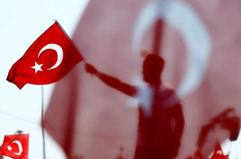 A man waves Turkey's national flag during the Democracy and Martyrs Rally, organized by Turkish President Tayyip Erdogan and supported by ruling AK Party (AKP), oppositions Republican People's Party (CHP) and Nationalist Movement Party (MHP), to protest against last month's failed military coup attempt, in Istanbul, Turkey, August 7, 2016. REUTERS/Umit Bektas