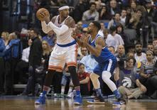Nov 12, 2016; Toronto, Ontario, CAN; New York Knicks forward Carmelo Anthony (7) controls the ball as Toronto Raptors guard Norman Powell (24) defends during the third quarter in a game Knicks at Air Canada Centre. The Toronto Raptors won 118-107. Mandatory Credit: Nick Turchiaro-USA TODAY Sports