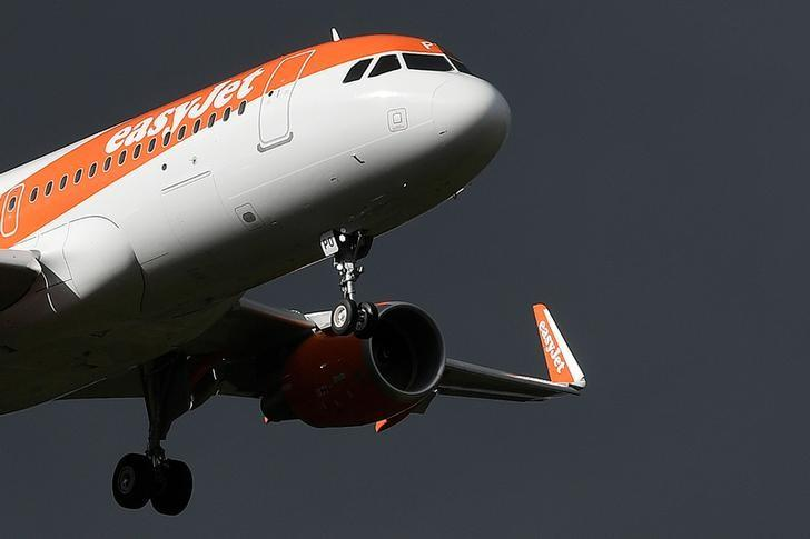 An EasyJet passenger aircraft makes its final approach for landing at Gatwick Airport in southern England, Britain, October 9, 2016. REUTERS/Toby Melville