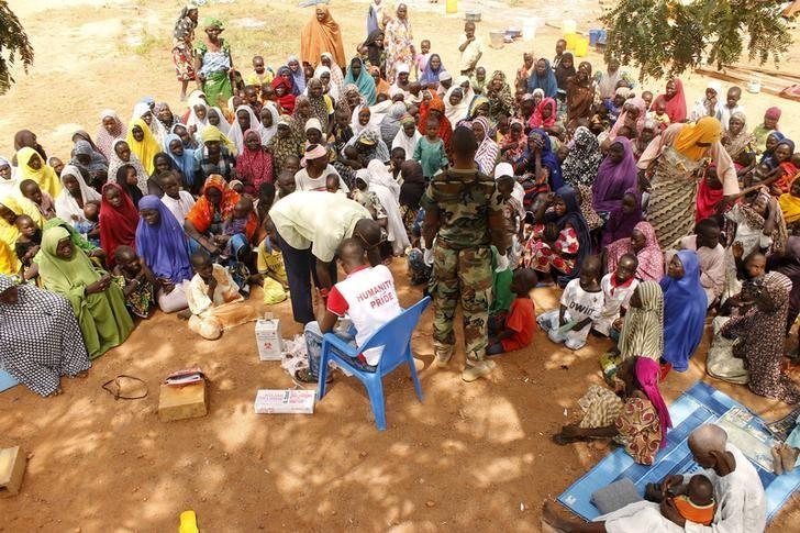 People who were rescued after being held captive by Boko Haram, sit as they wait for medical treatment at a camp near Mubi, northeast Nigeria October 29, 2015. REUTERS/Stringer