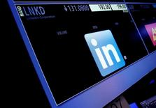 The ticker symbol and trading information for LinkedIn Corp. is displayed on a screen  at the post where it is traded, before the start of trading, on the floor of the New York Stock Exchange (NYSE) in New York City, U.S., June 13, 2016.  REUTERS/Brendan McDermid/File Photo