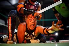 Wrestler known as Gio Malkriado (top) fights with a fluorescent tube with wrestler Ciclope during an extreme wrestling fight at a temporary wrestling ring inside a car wash in Tulancingo Hidalgo, Mexico October 8, 2016.  REUTERS/Carlos Jasso