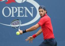 Sep 1, 2016; New York, NY, USA; Feliciano Lopez of Spain hits to Joao Sousa of Portugal on day four of the 2016 U.S. Open tennis tournament at USTA Billie Jean King National Tennis Center. Mandatory Credit: Jerry Lai-USA TODAY Sports