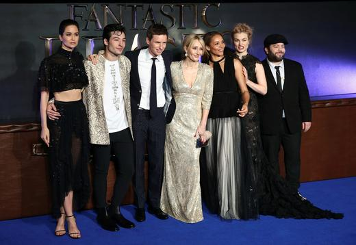 Writer J.K. Rowling (C) poses with members of the cast as they arrive for the European premiere of the film