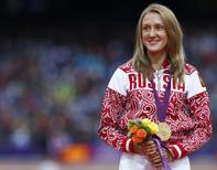Russia's Yuliya Zaripova receives her gold medal during the women's 3000m steeplechase victory ceremony at the London 2012 Olympic Games at the Olympic Stadium August 7, 2012.  REUTERS/Eddie Keogh