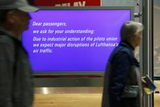 Passengers walk past an information display during a pilots strike of German airline Lufthansa at  Frankfurt airport, Germany, November 23, 2016. REUTERS/Ralph Orlowski
