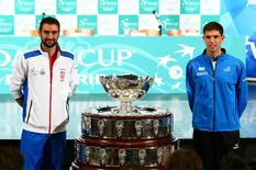 Croatia's tennis team player Marin Cilic (L) and Argentina's tennis team player Federico Delbonis pose for a picture after the official draw for their Davis Cup finals in Zagreb, Croatia November 24, 2016.  REUTERS/Antonio Bronic