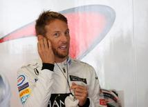 Formula One - Japanese Grand Prix - Suzuka Circuit, Japan - 8/10/16.McLaren's driver Jenson Button of Britain  prepares to wear his helmet during the third practice session. REUTERS/Toru Hanai