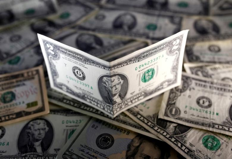 U.S. dollar notes are seen in this November 7, 2016 picture illustration. REUTERS/Dado Ruvic/Illustration/File Photo