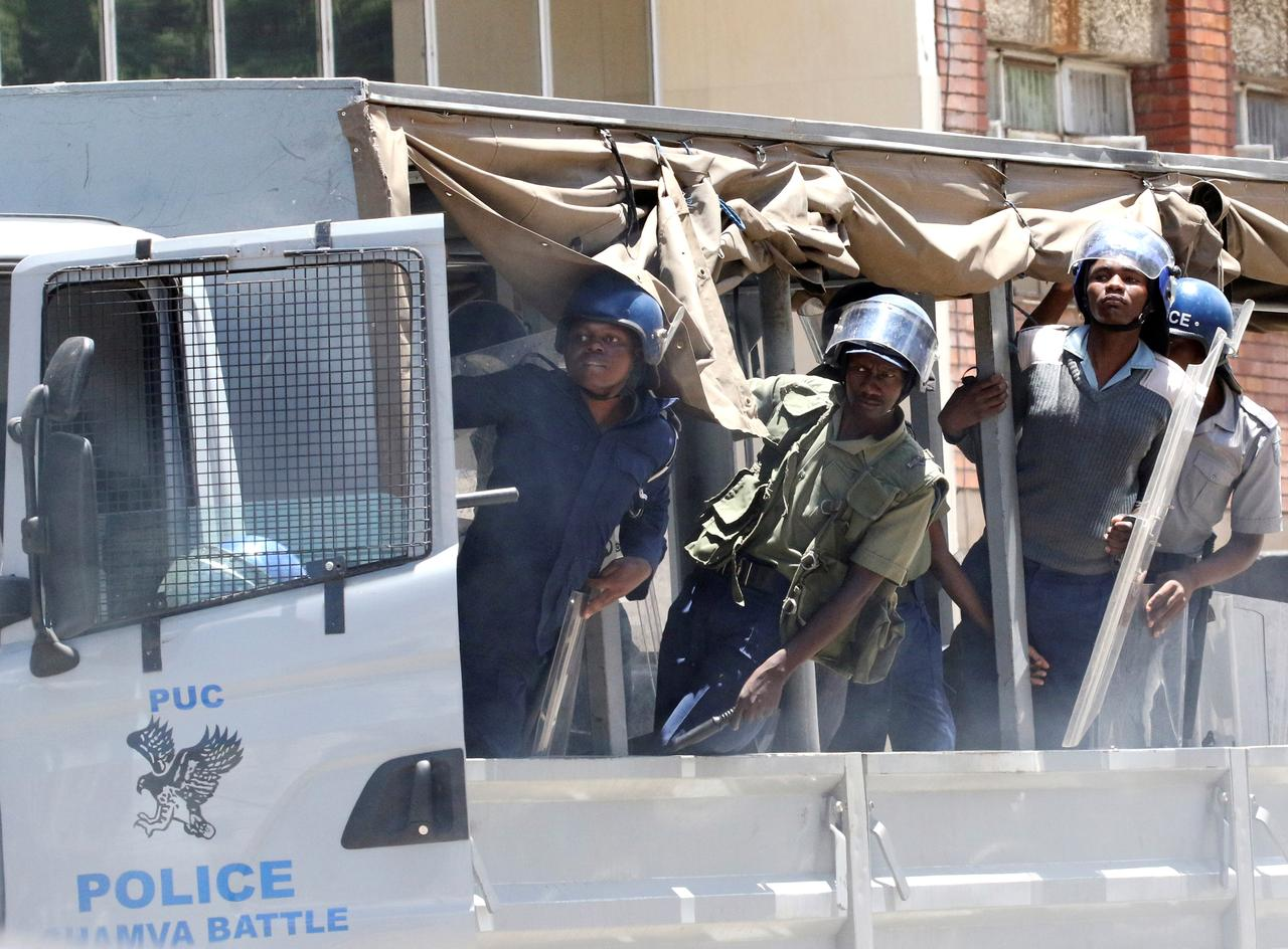 Zimbabwe police use water cannon against fake money protest - Reuters