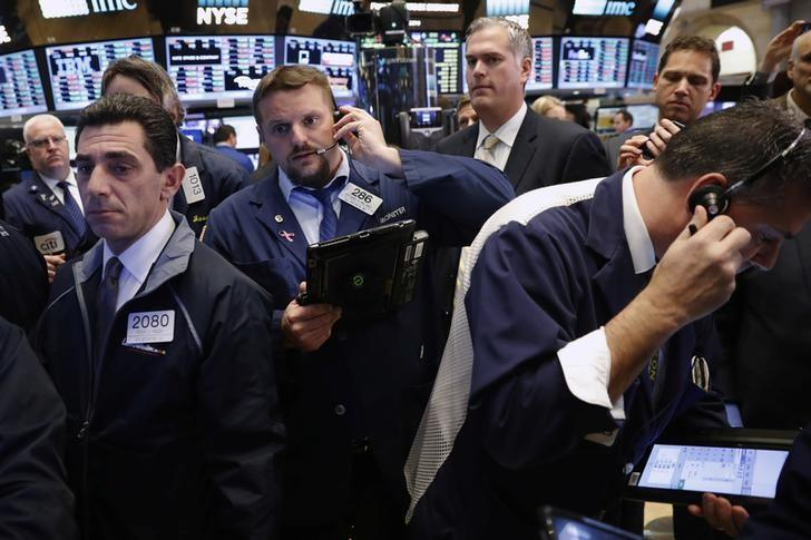 Traders work on the floor of the New York Stock Exchange (NYSE) shortly after the opening bell in New York City, NY, U.S. November 15, 2016. REUTERS/Lucas Jackson