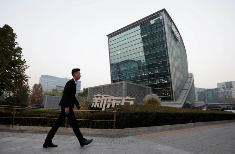 A man walks past New Oriental Education & Technology Group headquarters in Beijing, China, November 16, 2016. REUTERS/Jason Lee
