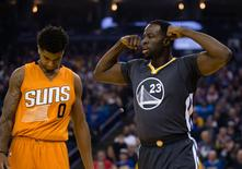 Dec 3, 2016; Oakland, CA, USA; Golden State Warriors forward Draymond Green (23) flexes his muscles ahead of Phoenix Suns forward Marquese Chriss (0) after a basket and one foul during the first quarter at Oracle Arena. Mandatory Credit: Kelley L Cox-USA TODAY Sports