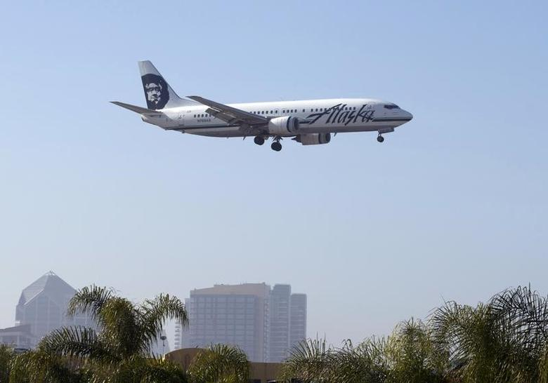 An Alaska Airlines plane is shown on final approach to land in San Diego, California April 4, 2016. REUTERS/Mike Blake
