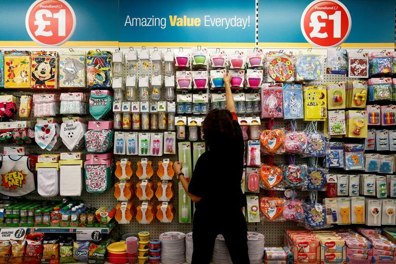 A Poundland employee checks products in a store in London, Britain November 10, 2015. REUTERS/Stefan Wermuth/File Photo