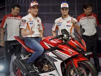 MotoGP rider Marc Marquez (L) and Dani Pedrosa (R) pose during the launch of a new Honda CBR150R at the Sentul Circuit, Bogor, West Java, Indonesia on February 14, 2016 in this photo taken by Antara Foto.  REUTERS/Yudhi Mahatma/Antara Foto
