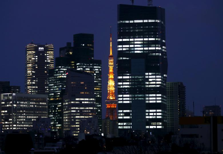 An illuminated Tokyo Tower (C) is seen between skyscrapers in Tokyo, Japan, March 10, 2016. REUTERS/Issei Kato/File Photo
