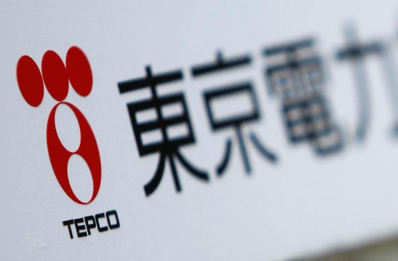 A Tokyo Electric Power Co (TEPCO) logo is pictured on a sign showing the way to the venue of the company's annual shareholders' meeting in Tokyo June 28, 2011. REUTERS/Yuriko Nakao/File Photo