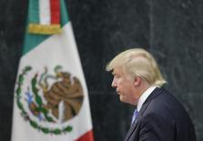 U.S. Republican presidential nominee Donald Trump walks past a Mexican flag after giving a press conference with Mexico's President Enrique Pena Nieto at the Los Pinos residence in Mexico City, Mexico, August 31, 2016. REUTERS/Henry Romero