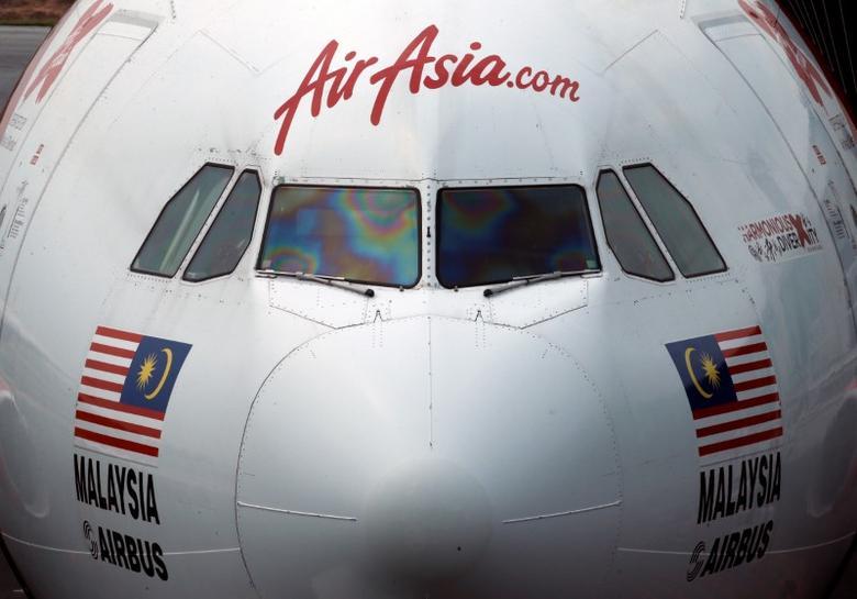An AirAsia plane sits on the tarmac at Kuala Lumpur International Airport, Malaysia August 28, 2016. REUTERS/Edgar Su/File Photo