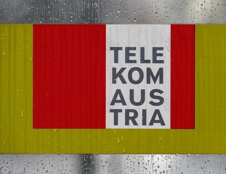 The logo of Telekom Austria is pictured on a phone booth during rainfall in Vienna, Austria, February 29, 2016. REUTERS/Heinz-Peter Bader