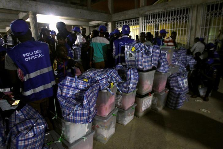 Polling agents stand next to ballot boxes at a collection center at the Odorkor police station in Accra, Ghana December 7, 2016. REUTERS/Luc Gnago