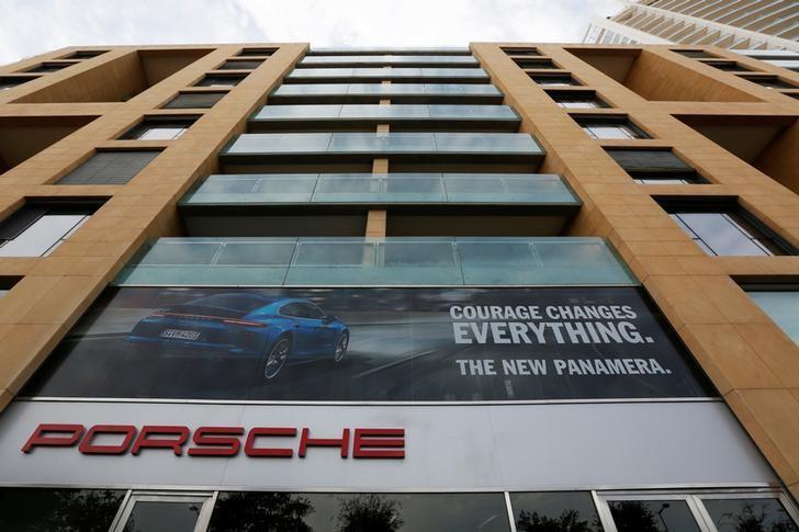 The logo of German car manufacturer Porsche is seen outside a showroom of a Porsche dealer in Beirut, Lebanon November 20, 2016. REUTERS/Jamal Saidi/Files