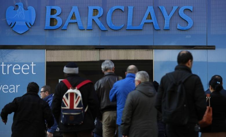Customers queue outside a branch of Barclays bank in Manchester northern England, March 17, 2016. REUTERS/Phil Noble/Files