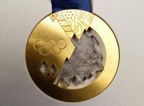 The gold medal for the 2014 Winter Olympic Games in Sochi is seen on display during a presentation in St. Petersburg May 30, 2013. REUTERS/Alexander Demianchuk
