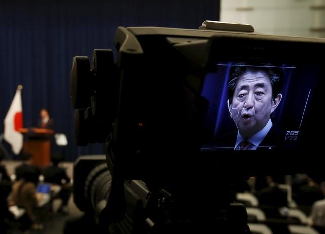A display of a video camera shows Japan's Prime Minister Shinzo Abe speaking during a news conference at his official residence in Tokyo, Japan, October 6, 2015. REUTERS/Yuya Shino/Files Photo
