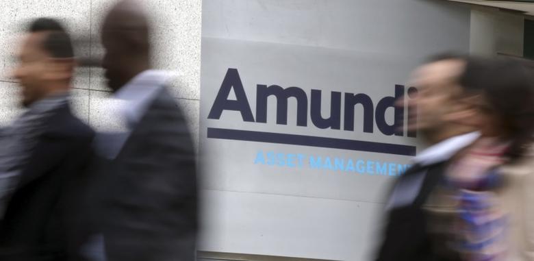People walk near the Amundi company headquarters in Paris, France, October 7, 2015. .   REUTERS/Philippe Wojazer