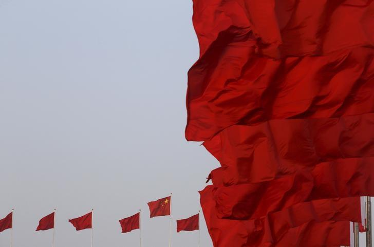 Chinese national flags flutter at Tiananmen Square ahead of the opening session of the National People's Congress (NPC) in Beijing, China, March 5, 2016. REUTERS/Kim Kyung-hoon