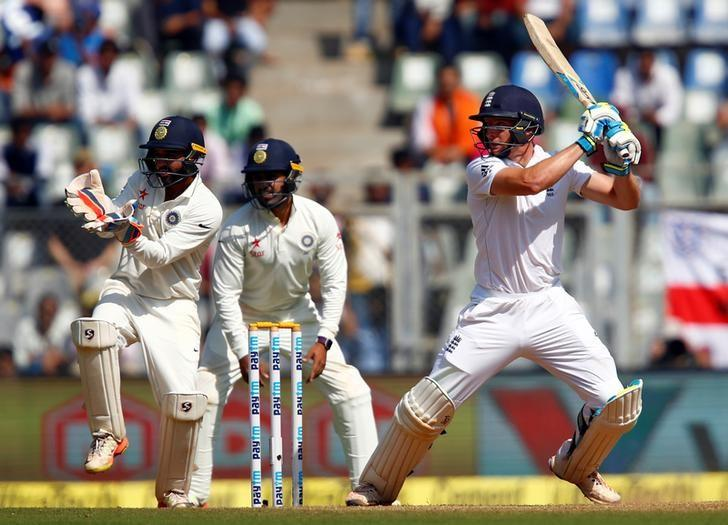 Cricket - India v England - Fourth Test cricket match - Wankhede Stadium, Mumbai, India - 9/12/16. England's Jos Buttler (R) plays a shot. REUTERS/Danish Siddiqui