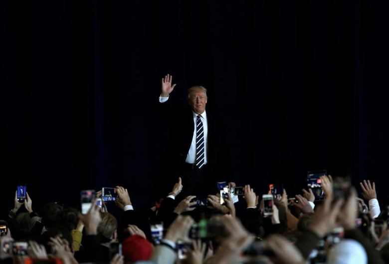 U.S. President-elect Donald Trump arrives to speak during a ''Thank You USA'' tour rally in Baton Rouge, Louisiana, U.S., December 9, 2016.  REUTERS/Mike Segar - RTSVGCE
