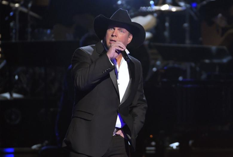 Garth Brooks performs a medley of songs with Trisha Yearwood (not pictured) at the 50th Annual Country Music Association Awards in Nashville, Tennessee, U.S., November 2, 2016.  REUTERS/Harrison McClary
