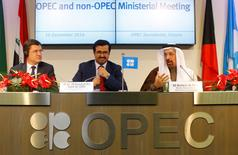 Russia's Energy Minister Alexander Novak, OPEC President Qatar's Energy Minister Mohammed bin Saleh al-Sada and Saudi Arabia's energy minister Khalid al-Falih (L-R) address a news conference after a meeting of the Organization of the Petroleum Exporting Countries (OPEC) in Vienna, Austria, December 10, 2016. REUTERS/Heinz-Peter Bader