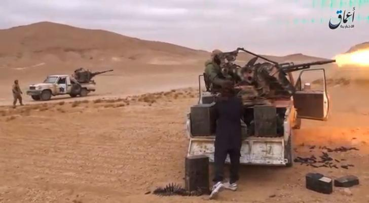 A still image taken on December 11, 2016 from a video released by Islamic State-affiliated Amaq news agency on December 10, 2016, purports to show Islamic State fighters advancing over the Hayan mountain south of Palmyra.   Handout via REUTERS TV