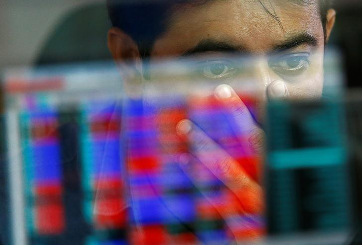 A broker reacts while trading at his computer terminal at a stock brokerage firm in Mumbai, India, November 9, 2016. REUTERS/Danish Siddiqui/Files